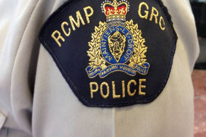 A file photo of an RCMP badge is shown.