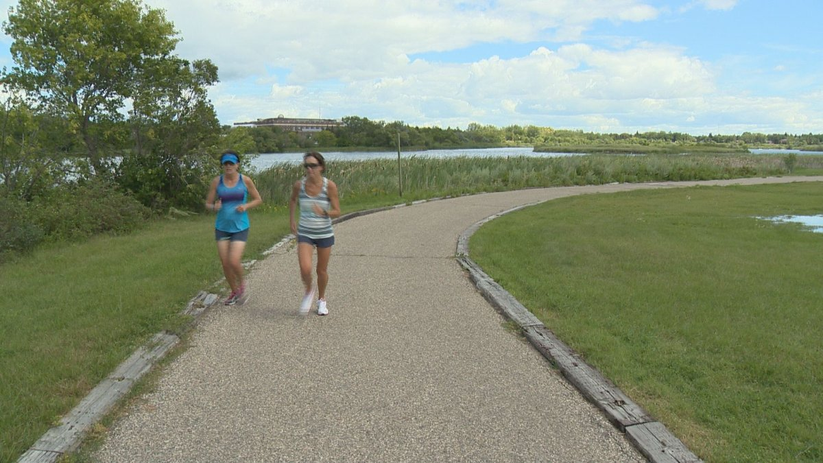 Two runners enjoy the path that surrounds Wascana Lake.