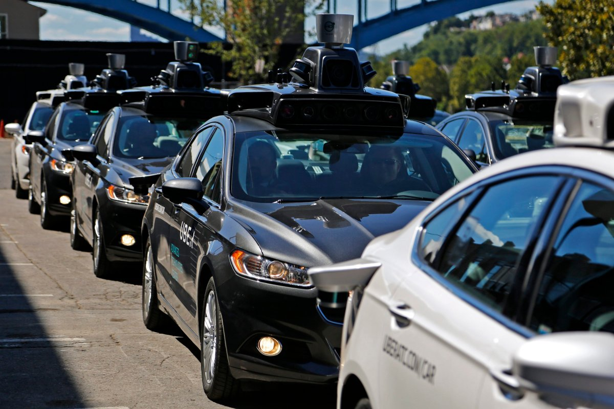 A group of self driving Uber vehicles position themselves to take journalists on rides during a media preview at Uber's Advanced Technologies Center in Pittsburgh, Monday, Sept. 12, 2016. Starting Wednesday morning, Sept. 14, 2016 dozens of self-driving Ford Fusions will pick up riders who opted into a test program with Uber. While the vehicles are loaded with features that allow them to navigate on their own, an Uber engineer will sit in the driver's seat and seize control if things go awry.