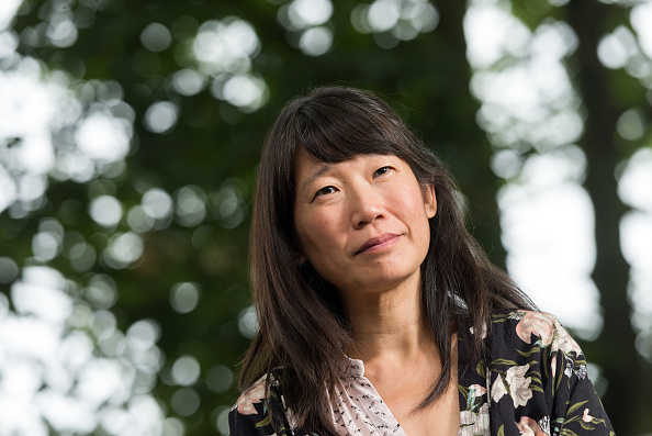 Canadian short story writer and novelist Madeleine Thien attends a photocall at Edinburgh International Book Festival at Charlotte Square Gardens on August 25, 2016 in Edinburgh, Scotland.  (Photo by Roberto Ricciuti/Getty Images).