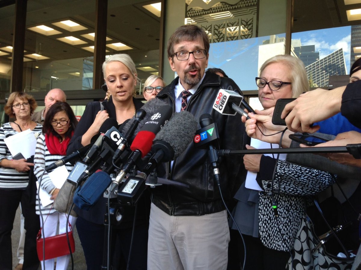Bret McCann, surrounded by family, speaks to the media after Travis Vader is found guilty of second degree murder in the death of McCann's parents, St. Albert couple Lyle and Marie McCann. September 15, 2016.
