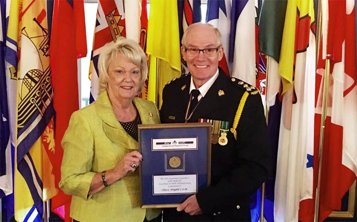 Vaughn Schofield presented Saskatoon Police Chief Clive Weighill with the 2016 Lieutenant Governor's Gold Medal on Tuesday.