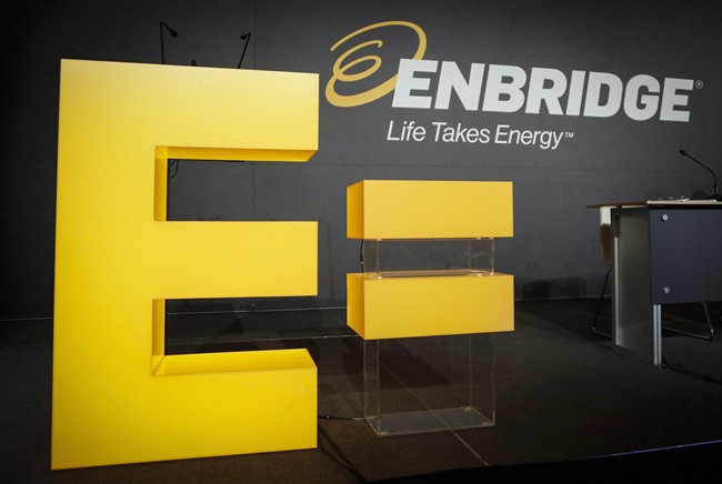 Enbridge company logos on display at the company's annual meeting in Calgary, .