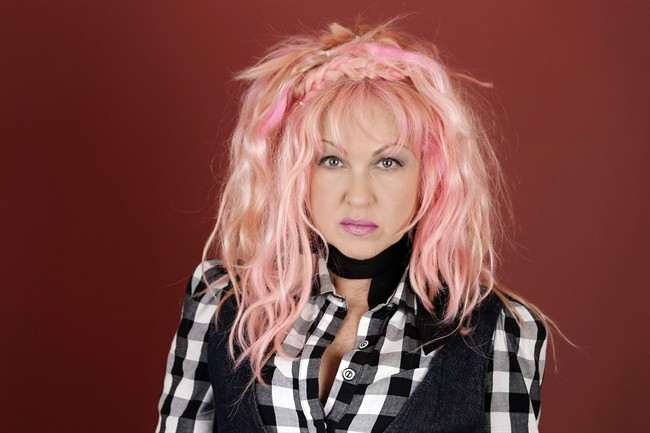 """In this March 14, 2016, photo, Cyndi Lauper poses in Nashville, Tenn., to promote her new country album, """"Detour,"""" releasing on Friday, May 6. Lauper has posted a message on her Facebook page voicing her opposition to Montreal's newly adopted breed-specific legislation. Thursday, Sept. 29, 2016."""