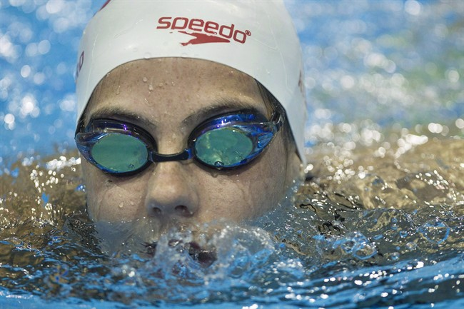 FILE - Canadian swimmer Aurelie Rivard and wheelchair racer Brent Lakatos broke Paralympic records in their respective morning heats on Friday at the Paralympic Games. Rivard swims during a media availability as the Canadian Paralympic Swim Team for Rio 2016 is announced in Toronto in an August 29, 2016, file photo.