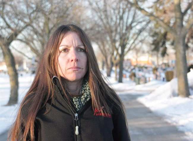 Denise Stark, mother of Cpl. Justin Stark, is seen at the cemetery where her son is buried in Hamilton, Ont., on Thursday, March 6, 2014. The mother of a Canadian soldier who killed himself after serving in Afghanistan will finally be honoured with a Memorial Cross this weekend, ending a long battle to have the military recognize his death as service related.