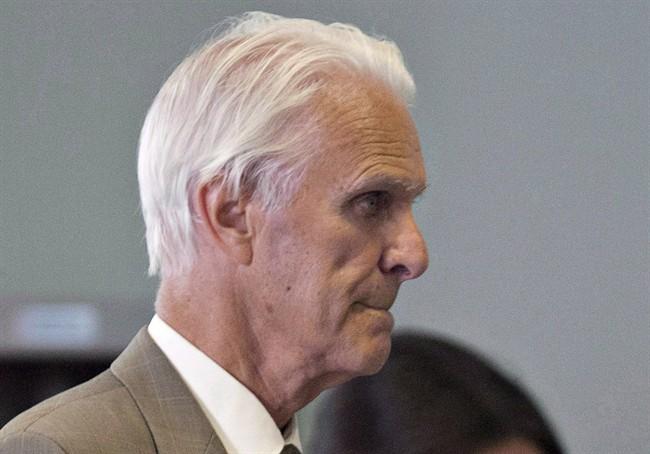 Former Quebec judge Jacques Delisle walks to court in Quebec City on June 14, 2012.