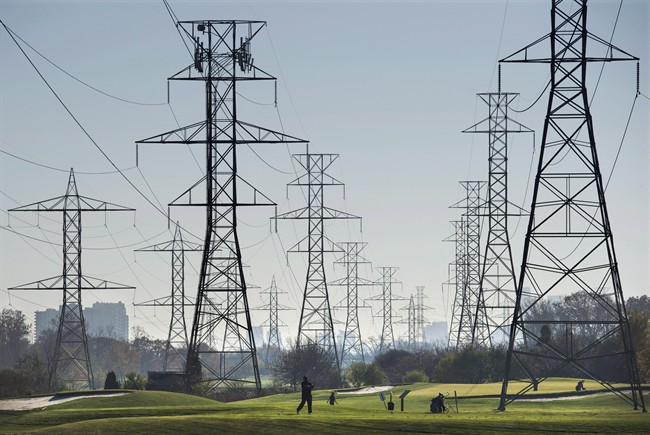 Hydro towers are seen over a golf course in Toronto on Wednesday, November 4, 2015.