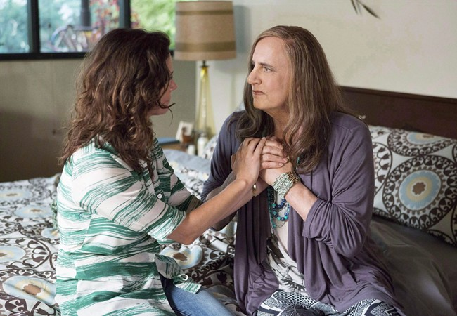 Jeffrey Tambor, right, as Maura Pfefferman and Amy Landecker as Sarah Pfefferman appear in a scene from 'Transparent.'.