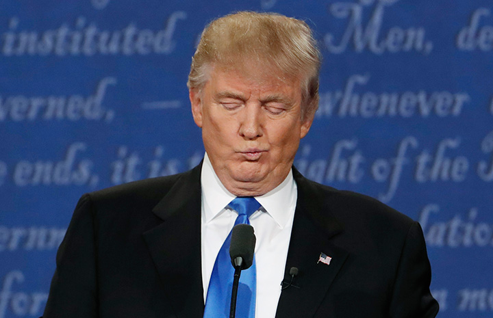 Republican presidential nominee Donald Trump reacts during the first presidential debate with Democratic presidential nominee Hillary Clinton at Hofstra University in Hempstead, New York, U.S., September 26, 2016.