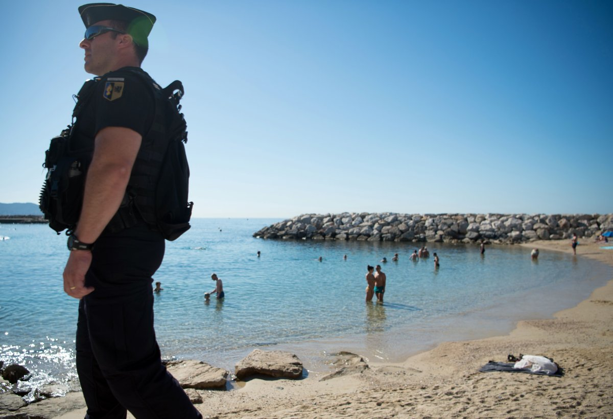 A French gendarme patrols on the beach during a visit of French Interior Minister in Toulon on August 14, 2016.