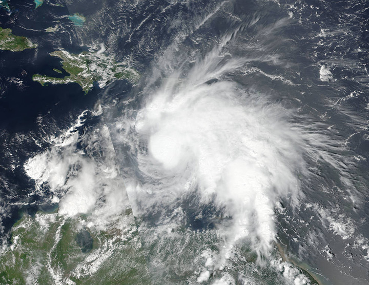 Hurricane Matthew grew into a powerful Category 3 storm on Friday as it crossed the Caribbean Sea on a course that could have it pounding Jamaica within days.