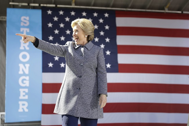 Democratic presidential candidate Hillary Clinton gestures as she takes the stage during a campaign stop in Des Moines, Thursday, Iowa, Sept. 29, 2016.