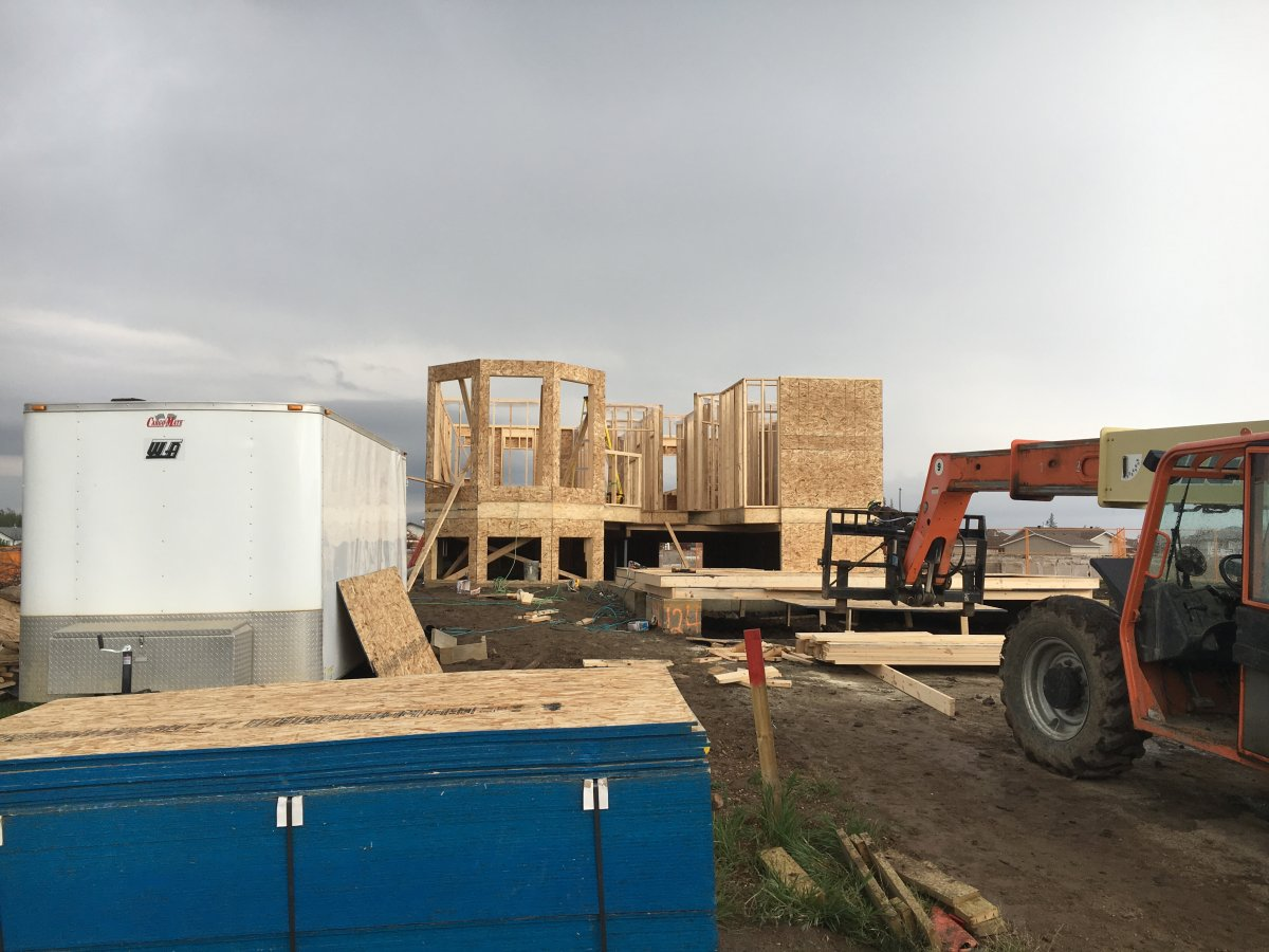 The first home to get a permit to be rebuilt in Fort McMurray sits framed. The contractor hopes it will be complete in December.