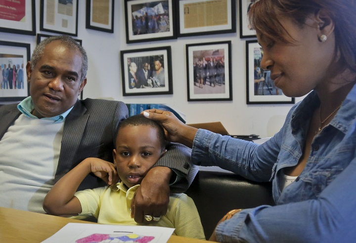 Raphael and Maribel Martinez comfort their son Andy after a press conference at their lawyer's office, Friday Sept. 30, 2016, in New York.  Maribel Martinez has filed a lawsuit against JetBlue Airways for mixing up Andy with another boy and flying him to the wrong city.