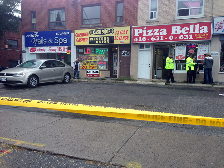 Police respond to a shooting at Cash Shop in Toronto on Sept. 23, 2016.