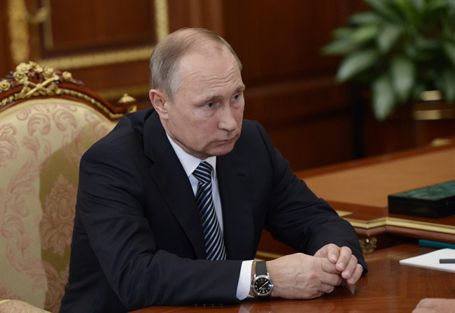 Russian President Vladimir Putin listens during a meeting with VTB CEP Andrei Kostin in Moscow's Kremlin on Tuesday, Sept. 27, 2016.