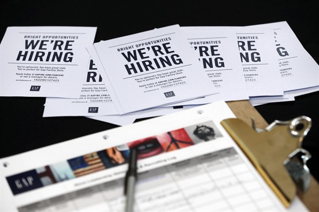 In this Tuesday, Oct. 6, 2015, file photo, job applications and information for the Gap Factory Store sit on a table during a job fair at Dolphin Mall in Miami.