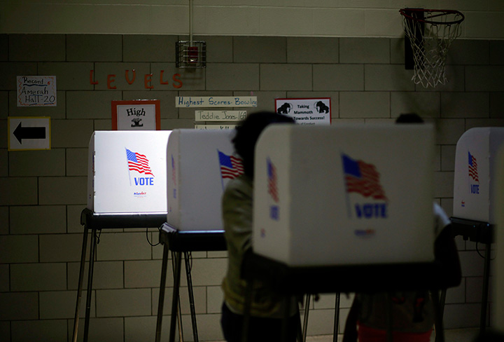 Sunlight shines through a window onto a voting booth at a polling place.