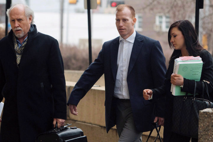 Travis Vader, centre, arrives at court with lawyer Brian Beresh, left, in Edmonton on March 8, 2016.
