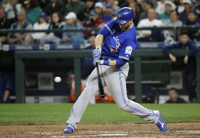 Toronto Blue Jays' Michael Saunders hits a two-run home run in the fourth inning of a baseball game, Tuesday, Sept. 20, 2016, in Seattle. Blue Jays' Troy Tulowitzki scored on the play.