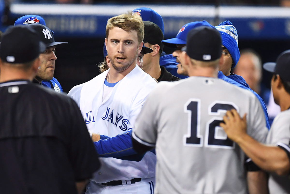 Toronto Blue Jays' Justin Smoak eyes down New York Yankees Chase Headley (12) during a bench-clearing melee.