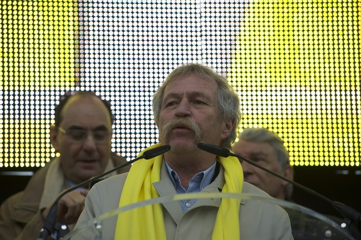 In this file photo, European MP Jose Bove delivers a speech during a demonstration on the Place Denfert-Rochereau, in Paris, on Jan. 28, 2016. Bove was expected to speak at a public event in Montreal Tuesday but was detained by the CBSA. Wednesday, Oct. 12, 2016.