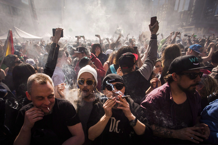 People smoke marijuana during a rally in Toronto,  April 20, 2016.