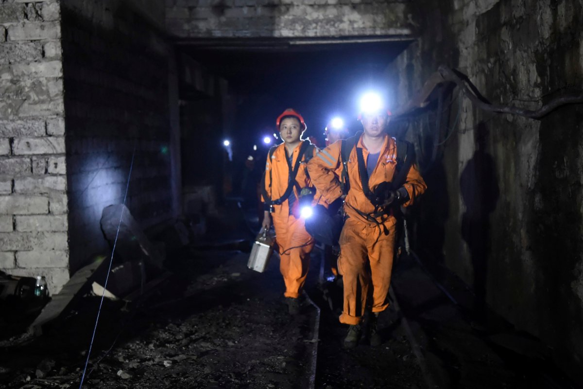 In this Monday, Oct. 31, 2016 photo released by China's Xinhua News Agency, rescuers work at Jinshangou Coal Mine in Chongqing, southwest China. Rescuers worked through the night at the privately owned Jinshangou mine where the explosion occurred before noon Monday, Xinhua News Agency reported.