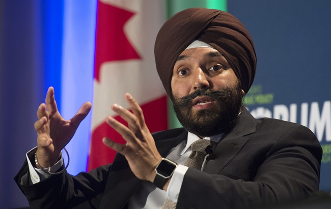 Innovation, Science and Economic Development Minister Navdeep Singh Bains responds to a question from the floor during a policy conference in Ottawa, Wednesday October 12, 2016. Bains said a new program that will fast track job permits for some foreign workers will help create more jobs for Canadians.