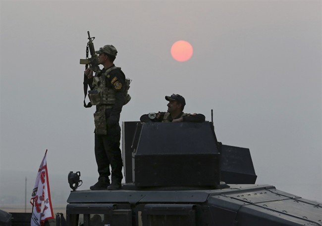 Iraq's elite counterterrorism forces advance toward Islamic State positions as fighting to retake the extremist-held city of Mosul enters its second week, in the village of Tob Zawa, outside Mosul, Monday, Oct. 24, 2016.
