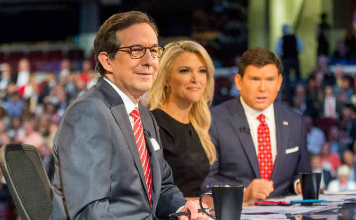 Fox News anchor Chris Wallace (left), with Megyn Kelly and Bret Baier, during the first Republican presidential debate on Aug. 6, 2015.  Wallace is the first Fox News personality to moderate a general election debate.