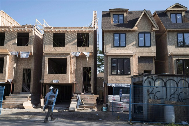 Houses under construction in Toronto are seen in a June 26, 2015, file photo.