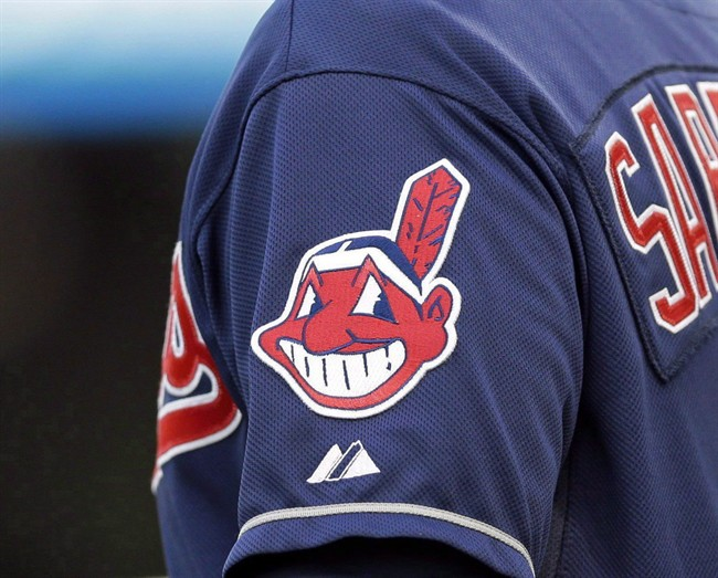 In this April 8, 2014 photo, the Cleveland Indians Chief Wahoo logo is shown on the uniform sleeve.