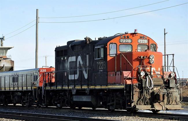 A CN locomotive goes through the CN Taschereau yard in Montreal, Saturday, Nov., 28, 2009.