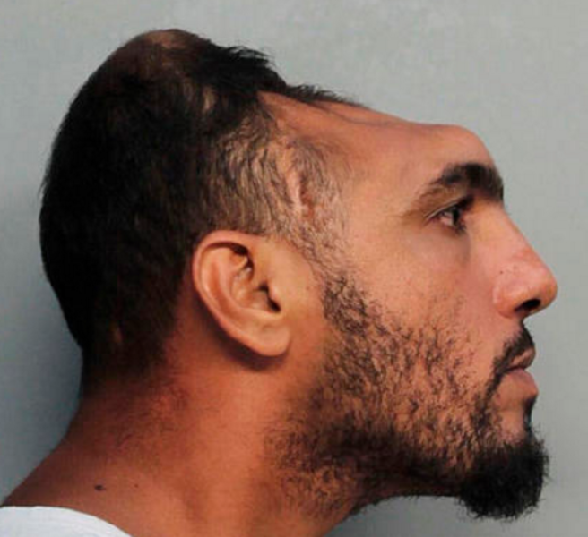 This Monday, Oct. 17, 2016, photo provided by the Miami-Dade Corrections and Rehabilitation Department shows Carlos Rodriguez, who is facing arson and attempted first-degree murder charges.
