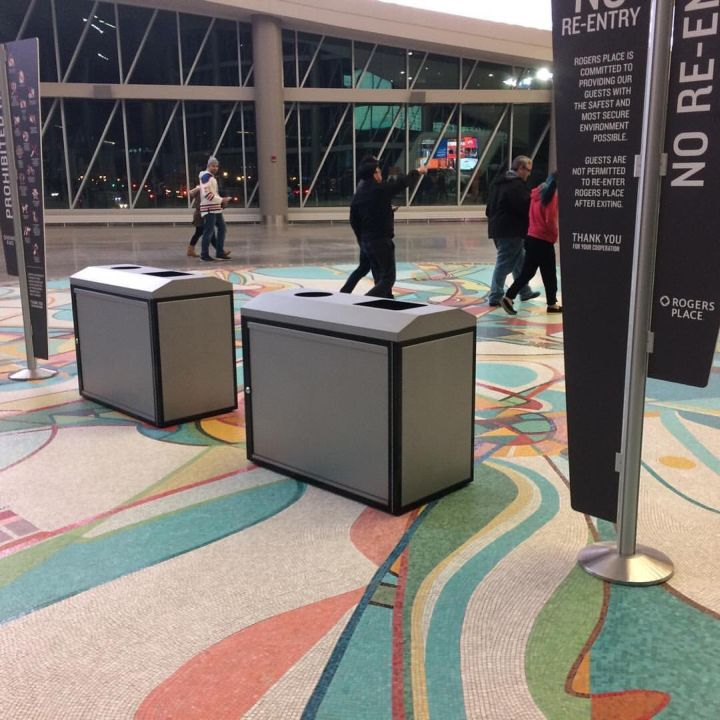 Rogers Place said it vows it will never again place garbage cans on the Iron Foot Place tile mosaic in Ford Hall after pictures of the arena doing just that caused public outcry on social media Wednesday, Oct. 12, 2016.