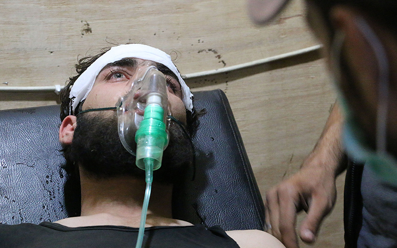 A Syrian man receives treatment at a field hospital following a chlorine gas attack by Assad regime forces in Jobar town of Damascus, Syria on July 30, 2015.