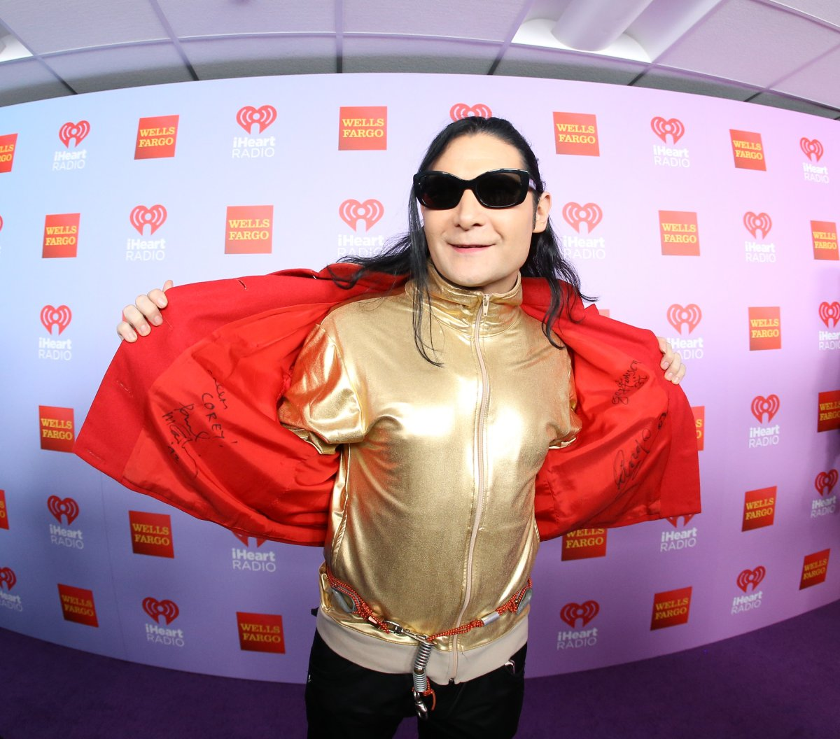 Corey Feldman shows off his autographed jacket of Paul McCartney, Ringo Starr and  George Harrison arrives at the iHeart80s Party 2016 on February 20, 2016 in Inglewood, California.