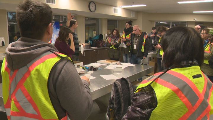 Volunteers get briefed before they begin a count of Edmonton's homeless population on Oct. 19, 2016.