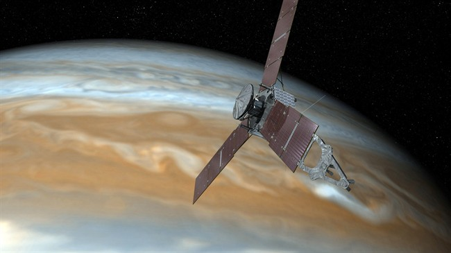 This undated artist's rendering shows NASA's Juno spacecraft making one of its close passes over Jupiter.