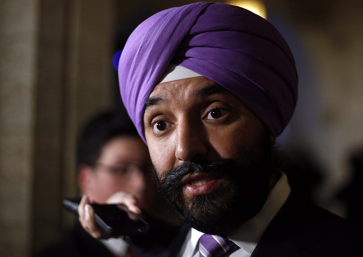 Navdeep Bains, Minister of Innovation, Science and Economic Development, talks to reporters in foyer of the House of Commons in Ottawa, to comment on the job cuts announcement made by Bombardier on Friday, October 21 2016.