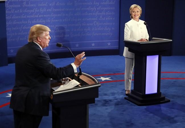 Republican presidential nominee Donald Trump debates Democratic presidential nominee Hillary Clinton during the third presidential debate at UNLV in Las Vegas, Wednesday, Oct. 19, 2016. (Mark Ralston/Pool via AP).