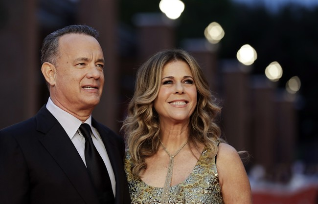 Actor Tom Hanks, left, flanked by his wife Rita Wilson, arrives to receive a lifetime achievement at the Rome Film Festival, in Rome.