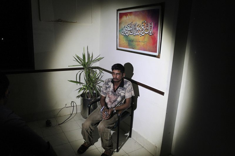 In this photo taken on Thursday, Sept. 1, 2016, Mubeen Rajhu, who killed his sister Tasneem sits at police headquarters in Lahore, Pakistan.