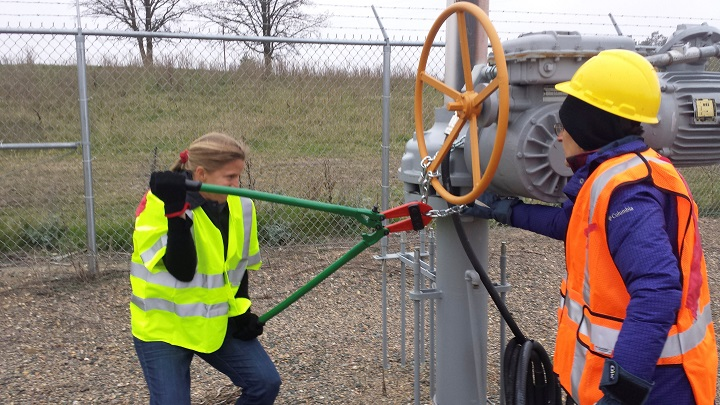 Activists are seen attempting to cut chains after trespassing into a valve station for pipelines carrying crude from Canadian oils sands into the U.S. markets near Clearbrook, Minnesota, U.S., in this image released on October 11, 2016.