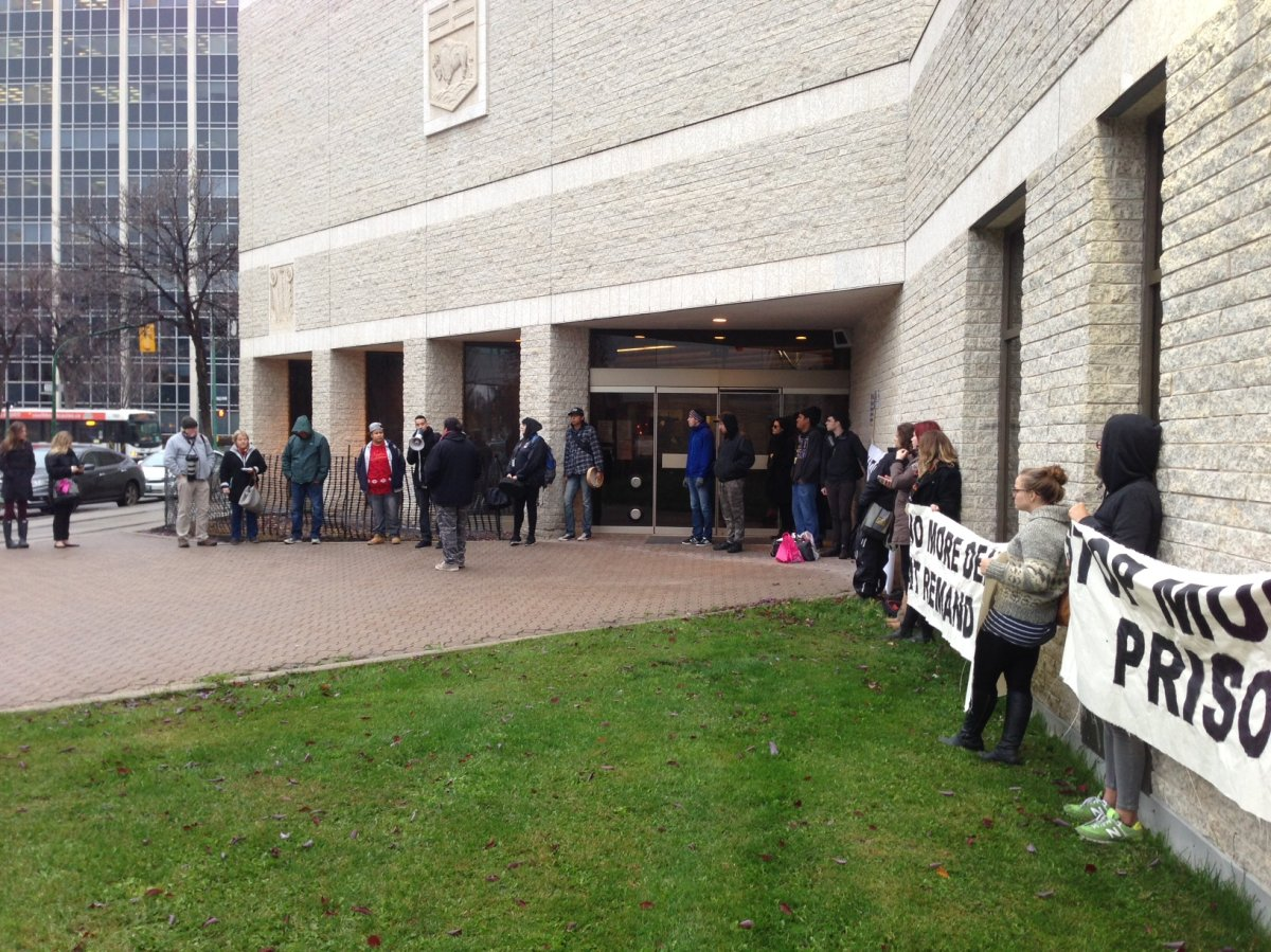A group protests at the Winnipeg Remand Centre Wednesday after four inmates died while in custody in the past year.