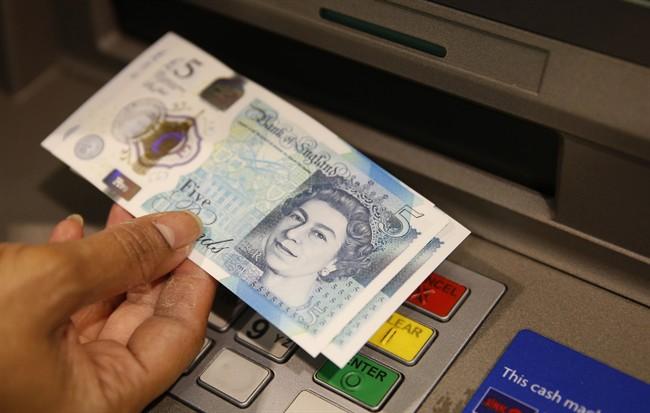 The British pound surged Thursday. (AP Photo/Alastair Grant, File).