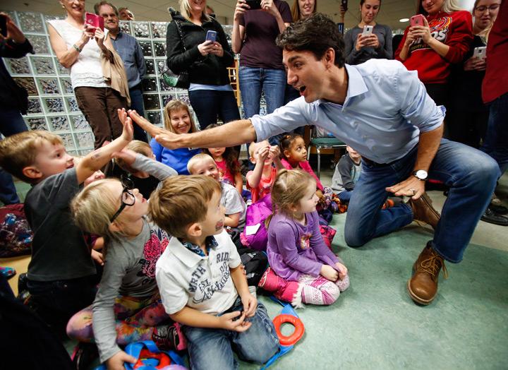 Prime Minister Justin Trudeau high fives pre-schoolers