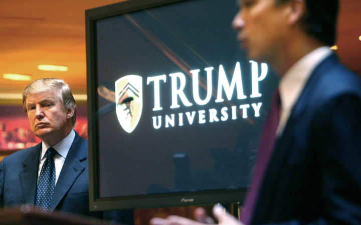 Donald Trump listens as he is introduced at a news conference in New York where he announced the establishment of Trump University. Trump is scheduled to go on trial this month in a class-action lawsuit against him and his now-defunct Trump University, potentially taking the witness stand weeks before his inauguration as president of the United States.